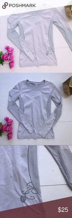 """Athlete Long Sleeve Athletic Top Flowers Athleta work out top. In very good condition. Some piling throughout. Shows light signs of wear. Has cute flowers on the back and some on the front. Stretchy work out material. Size small. Fits tight. Pit to pit 16"""". Length 25.5"""". Pit to end of sleeve 23"""". ::70 Athleta Tops Tees - Long Sleeve"""