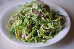 Shaved Brussels Sprout Salad with Red Onion, Lemon and Pecorino. Everything you heard about Brussels Sprouts as a kid is wrong, these things are quite tasty.