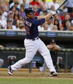 Minnesota Twins Danny Valencia connects for an RBI-single during the first inning in a baseball game against the Chicago White Sox, Monday, July 30, 2012, in Minneapolis. Minnesota won 7-6.