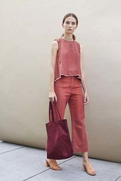 Co-ord and monochrome pale red minimal design sleeveless top and flared trousers matched with a burgundy shopper by Steven Alan Spring 2017 Ready-to-Wear Fashion Show