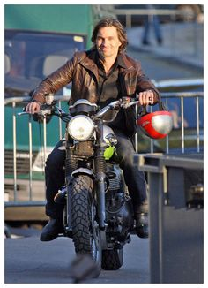 Olivier Martinez riding his Triumph motorcycle