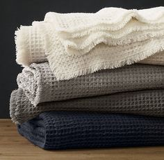 RH's Linen-Wool Waffle Weave Oversized Bed Throw:Generously sized for draping across the bed, our throw offers the warmth and lush texture of a deep, dimensional waffle-weave pattern. A garment washing process relaxes the classic linen-wool blend, giving it a supremely soft, hand-knitted quality for an added layer of luxury.