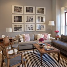 These white picture frames look great and take up a lot of space on that large wall. The striped rug really adds style to the room!