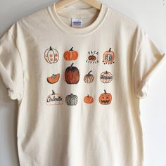 Hand Printed and Hand Drawn! This is a 100% cotton screen printed t shirt with a hand drawn illustration showing many varieties of pumpkins, like Lumina, Sugar,Cinderella, Connecticut Field and Jack be Little. Its perfect for fall! The shirt shown here is Natural and printed in orange and