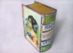 beautiful Russian tin box that held soap shaped like a book...on ebay $65