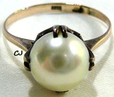 Vintage Estate 12k Gold Ring with a Solitaire 7.8mm White Cultured Pearl in excellent condition. Ring Size 5.5. Pearl Set in Gold (12k hallmark). Ring has been re-sized and needs cleaning. Would make a nice engagement ring. www.etsy.com/shop/SylCameoJewelsStore