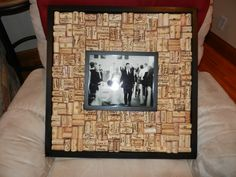 Alternative guest book...guests sign corks then you glue them into a frame.