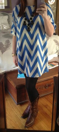 Blue chevron dress, black tights, black bubble necklace, and cowboy boots... Love