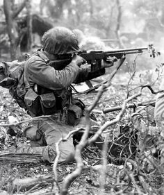 "US Marine lets loose with his M1918 Browning Auto Rifle somewhere in the Pacific. Chambered for the .30-06 Springfield rifle cartridge, the M1918 was the light auto weapon at platoon level that was supposed to be deployed in a ""walking fire"" mode -- blasting from the hip. In practice, the M1918 was mostly fired with the help of its bipod or like a conventional rifle, provided the shooter could withstand the recoil."