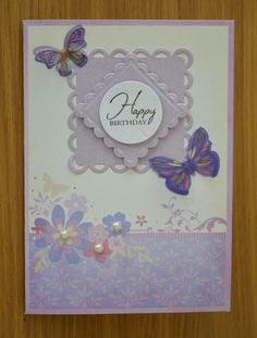 Birthday card using spellbinders lacey squares and butterfly embellishment