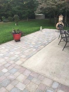 Extending concrete patio with pavers by lucia