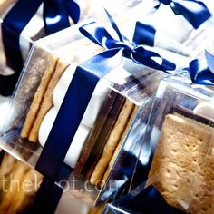 I chose these as part of my wedding favors. Everybody can have their own s'mores. Plus, it has a royal blue ribbon around the box.