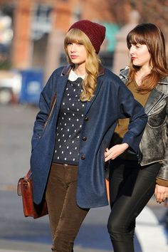 Taylor Swift Wool Coat - Taylor tossed on this navy wool topper with chocolate brown leather detailing for an outing in NYC. . . . Taylor Swift Crewneck Sweater - Taylor was born to wear the Peter Pan collar trend AND polka-dots.  What a perfectly retro combination.