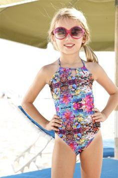 Designer Kids Printed One Piece  This fabulous Peixoto Kids Tamarin One Piece will be on every girl's wish list! It's fun designer print makes it stand out from all other one pieces. The swimsuit has ties in the back which provides the perfect fit for any type of beach day.