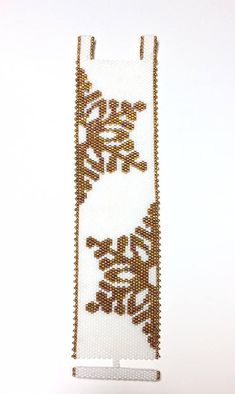 This is a Beautiful Beaded Peyote Revised Golden Snowflake Bracelet. The dimensions for this bracelet are approximately 1.59in-inch width x 7.06in-inch length when using 11/0 Delica seed beads. There is a total of 2 bead colors, with a total bead count of 3060 beads (30 beads by