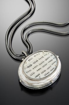 Counting the Days pendant by Mammetal on Flickr. Silver, recycled ivory piano keys