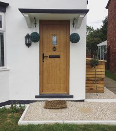Wood affect front door from olivair home improvements  White rendered house, village