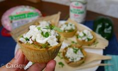 These cupcake tamales start with a masa base, loaded with chicken in a green chile salsa, and after they are done they are topped with Cacique Queso Fresco, Cacique Crema Mexicana Agria and chopped fresh cilantro. Simply delicious! #GoAutentico #SoCu #ad