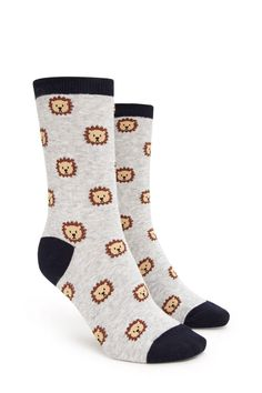 A pair of knit crew socks featuring an allover lion print, ribbed trim, and a contrast heel and toe.