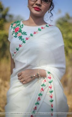 Featuring the Creamery pure silk-chiffon cream colored saree with delicate red and apricot floral embroidery and green leaves hand-crafted with ribbonwork all along Chiffon Saree, Saree Dress, Silk Chiffon, Saree Blouse, Saree Embroidery Design, Embroidery Dress, Floral Embroidery, Border Embroidery, Saris