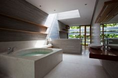 I would have put the tub closer to the window, but this is beautiful. Stacking Green by Vo Trong Nghia Architects