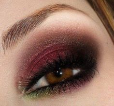"""This look is not for the faint of heart. All these colors can be found in nature, but, if you aren't familiar with a foundation, be careful. Red shadows can make eyes seem puffy because they draw the natural red undertones of your skin. That said, this look is the perfect way to say, """"I am a suductress, and I demand romance."""""""