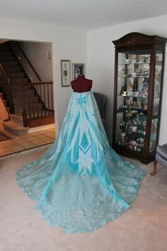 diy frozen elsa cosplay - Google Search...Finally someone is making me my dress! Wish I could see the front.