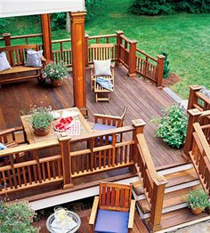 Squared Posts Deck Railing. I like the deck but railing would be what we use in front. A simple iron I think.