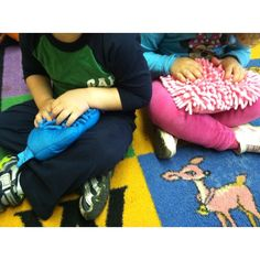 Dusting or car wash mit, fill with rice and sew the end... Great for sensory and keeping kids still during circle time!