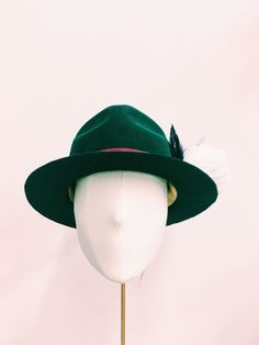 Cecile Millinery, forest green rabbit fur hat . Hand made in London