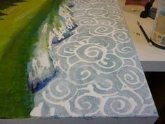 painting abstract patterns for coulds in the sky