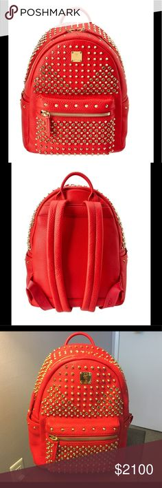 """🔥MCM DIAMOND STARK BACKPACK - RED - NWOT $2,550🔥 •MCM SMALL backpack in pebbled lambskin leather with gold tone hardware.  •Pointed-stud and crystal embellishments.  •Flat top handle.  •Adjustable shoulder straps. Approximately 13.5 inch drop  •Two-way zip around top closure.  •Exterior front zip pocket.  •Individually numbered logo plate.  •Inside, fabric lining; one zip and one slip pocket.  •Approximately: 13""""H x 10.2""""W x 4.9""""D.  •Bag weighs approx. 3lbs. 4oz…"""