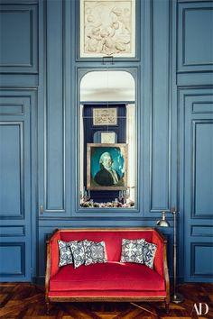 A Louis XVI sofa is dressed in a Lelièvre velvet from Scalamandré; Casa Lopez pillows   archdigest.com