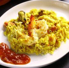 Receita de risoto de frutos do mar ao molho de curry gratinado
