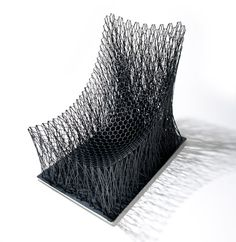This chair was created by intertwining carbon fibre strings into a pattern designed to resemble the branches of trees