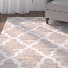 <p>The Eberhardt area rug by Three Posts is an elegant foundation for any of your home's ensembles, whether it is covering the dining room or foyer wood floor.</p></p> Hand woven from 100 percent cottone pile, this beautiful flat weave rug is embellished with a quatrefoil trellis motif in beige and ivory hues for a touch of pattern and color that blends seamlessly with an array of sophisticated aesthetics.</p><p>Use it to tone down a room painted w...