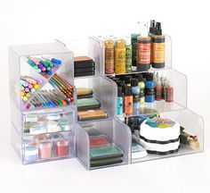 Customized Station Modular storage is a crafter's dream because it allows for rearranging of work space to meet current needs. These inexpensive modules come in various shapes and designs to custom-fit tools. The X-cube is perfect for sorting pens, pencils, and markers, while stackable units hold pigment inks and dye-base ink pads
