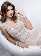 Simone - by Maggie Sottero...saw this dress in store - beautiful pink lace over antique white dress. Gorgeous!