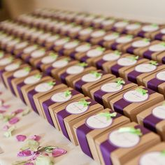 11 Ways to Save on Wedding Favors - I didn't read this but I liked the picture. Cute little brown boxes with blue and green ribbons.
