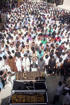 People offer funeral prayer of Ahsan Abbas, Zia Mehdi and Junaid, who were gunned down in a firing incident last night, at Khair-ul-Amal mosque at Incholi Society in Karachi on Tuesday, May 01, 2012.