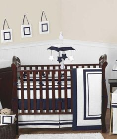 Loving this navy and white bedding for my baby boy!