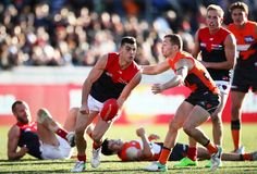 Corey Maynard of the Demons handballs during the round 20 AFL match between the Greater Western Sydney Giants and the Melbourne Demons at UNSW Canberra Oval on August 5, 2017 in Canberra, Australia.