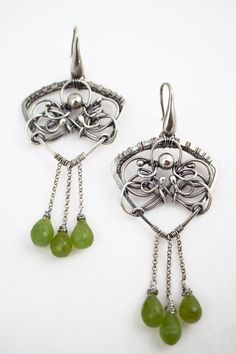 Long, feminine, romantic and eye-catching dangle earings. Made entirely by hand from fine and sterling silver wire with silversmiths and wire wrapping technique. Green drops of natural peridote dance when move them. Patinated and polished. ____________________ Total lenght is 8,5 cm ( 3.35 inch) Width 3,5 cm (1.38 in) Weight of each piece is 10,37 gr. ____________________ Do not wet. ____________________ Certain metal after a small time slightly darken. You can clean silver jewelry with a…