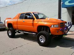 dodge ram lifted custom orange paint off road by hondasniper, via Flickr