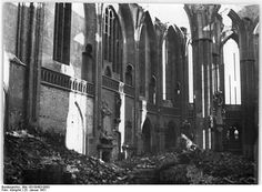 This is the interior of the church ruine five years after the war. Inside the Nicolaikirche, there were many artistically significant funerary chapels and epitaphs. In the middle of January 1951, it was discovered that non-ferrous metal thieves in the tombs had made a mischief and stolen numerous coffins. Zinc coffins, jewelry etc. were stolen. These are mostly buried councilors and merchants from the 16th century.  [Photo: Bundesarchiv_Bild_183-09403-0003.] .