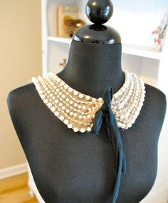 Get some mesh tulle from the fabric store to create a peter pan collar, then embellish with pearls,