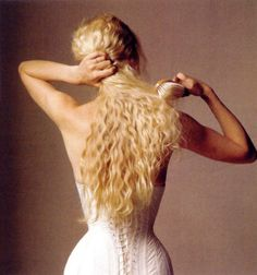 "love the classic ""curls tumbling down the corseted back"" look."