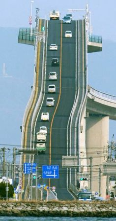 Eshima Ohashi Bridge, Japan The bridge looks more like a roller coaster than a road. The Eshima Ohashi Bridge in Japan rises so. Places To Travel, Places To See, Scary Places, Places Around The World, Around The Worlds, Scary Bridges, Dangerous Roads, Mario Kart, Roller Coaster