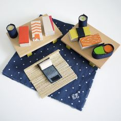 Kukkia Gg Sushi Set: With this wonderful wooden sushi set, you can enjoy tuna yellowtail salmon egg and shrimp and there are also Maki rolls of cucumber, Sea urchin and pickled radish.  Seaweed is made from denim with a Velcro fastening, so you can roll your own little maki sushi using the cute bamboo rolling mat provided. Made from natural Japanese FSC wood. For ages 3 years+
