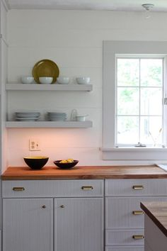 Ship lap behind kitchen shelves in a New England kitchen